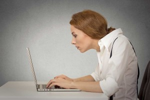slouched woman at desk